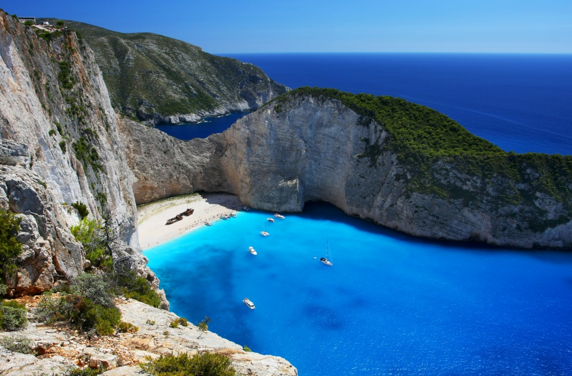 'Navagio - the most famous beach on Zakynthos island with shipwreck and anchoring boats  (Greece, Ionian islands)' - Zante